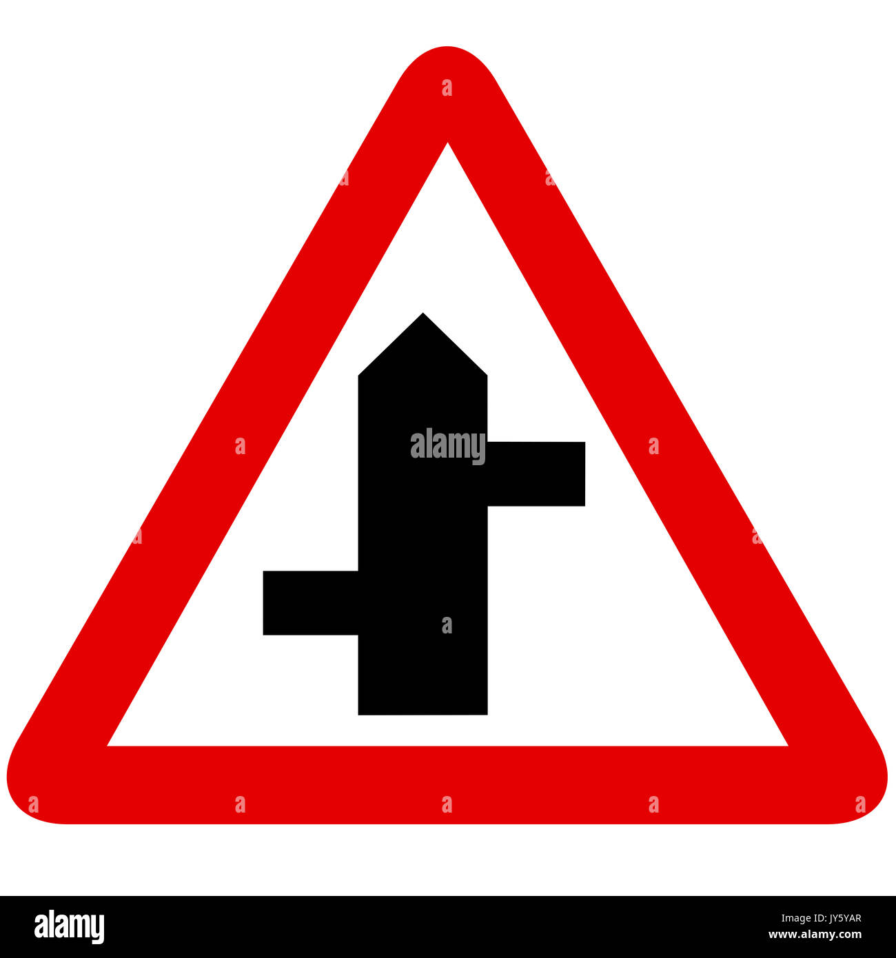 Staggered junction road sign on white background - Stock Image
