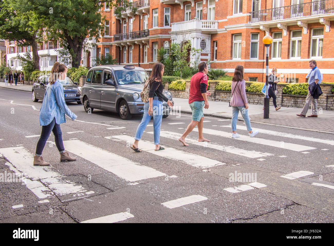 People recreating the famous Abbey Road Beatles Cover - Stock Image