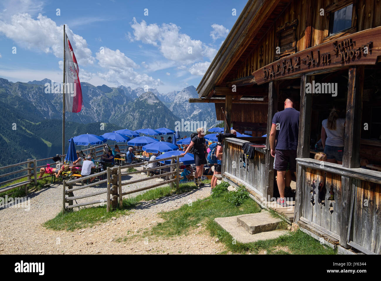 Dalfazalm alp and mountain hut on a sunny day crowded with hikers, Tyrol, Austria - Stock Image