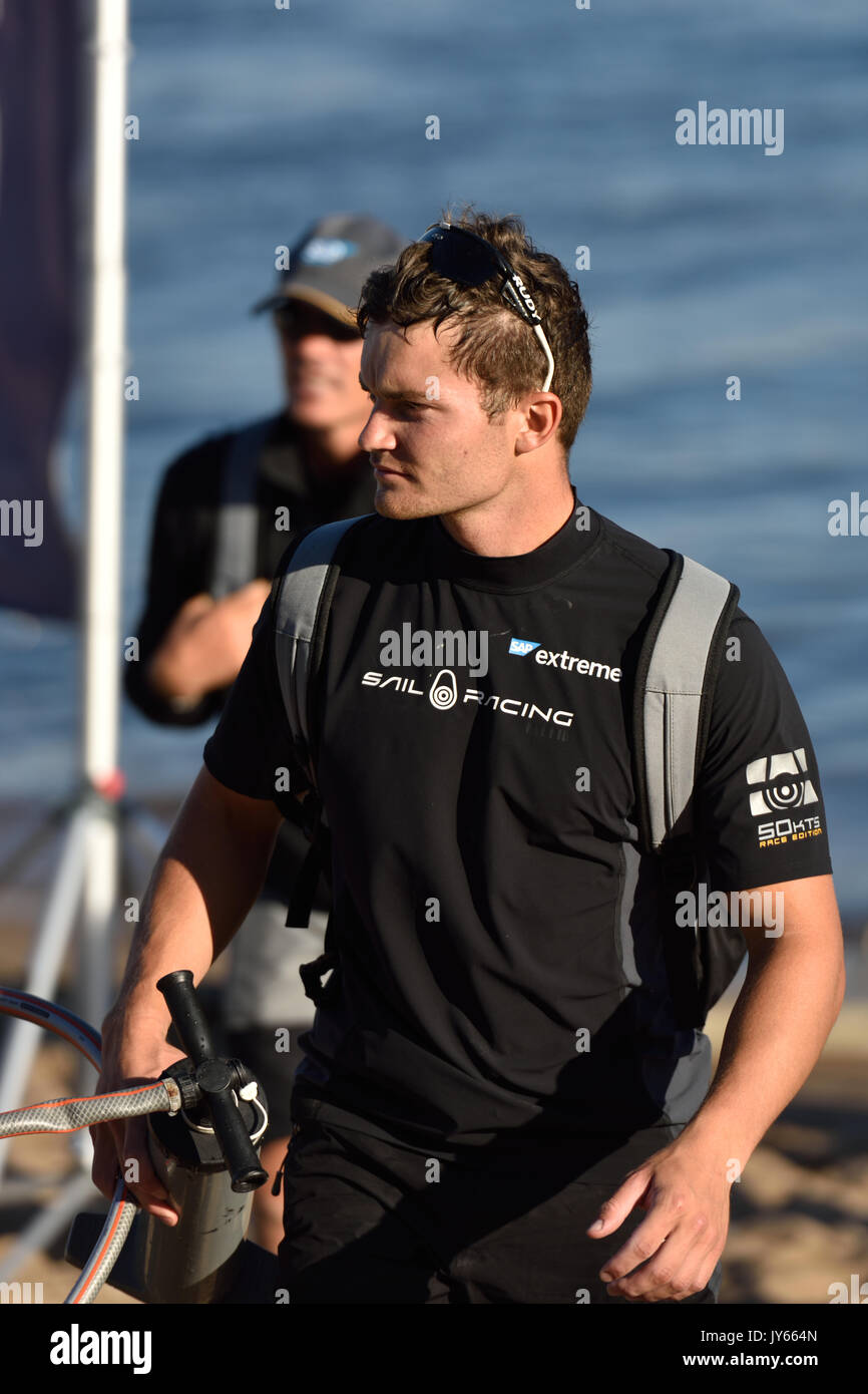 St. Petersburg, Russia - August 21, 2015: Mainsail trim Mads Emil Stephensen from the SAP Extreme Sailing Team of Denmark after the 2nd day of St. Pet - Stock Image