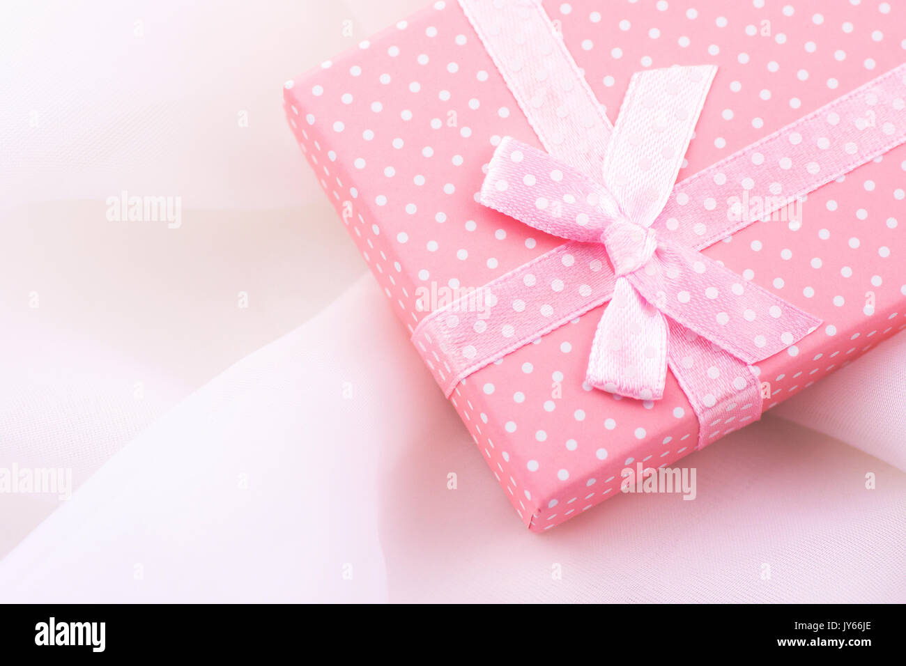 Pink Gift Box Tied With Satin Ribbon With Bow On Delicate White