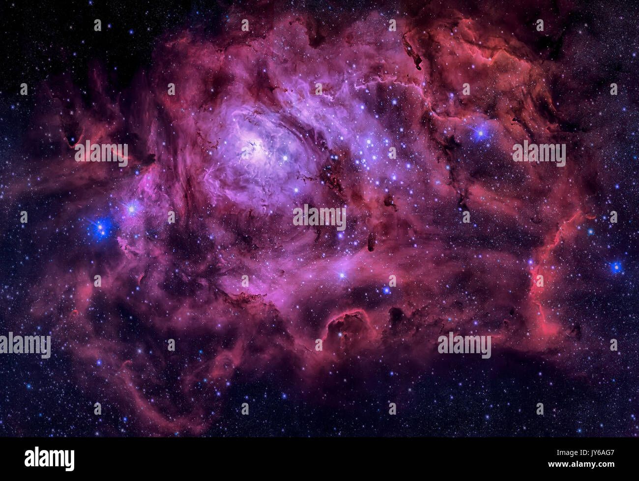 Lagoon Nebula. This giant cloud of gas and dust is creating intensely bright young stars, and is home to young stellar clusters. Retouched colored ima - Stock Image