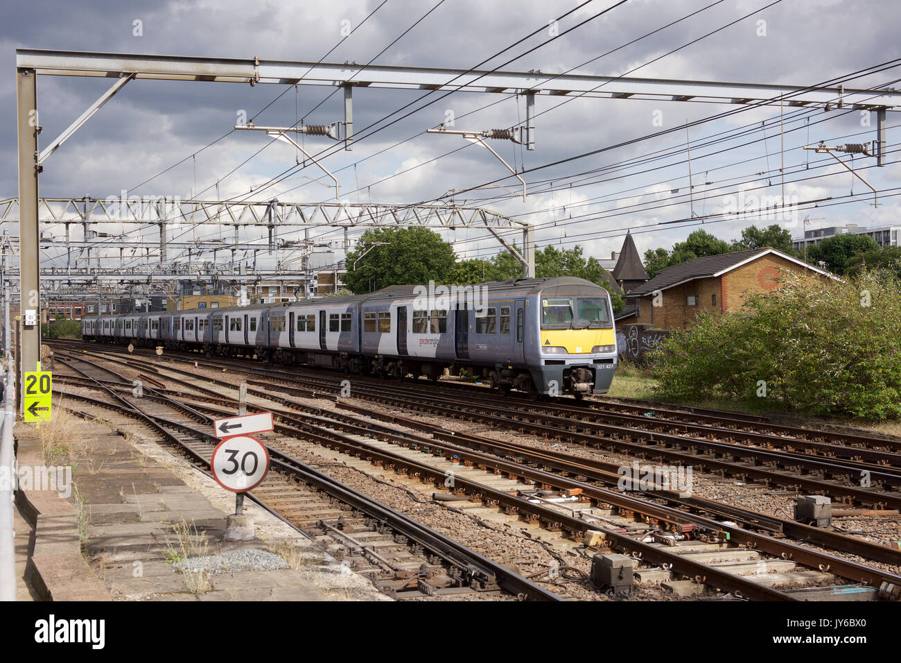 Greater Anglia Electric Multiple Unit train passing Bethnal Green in London - Stock Image