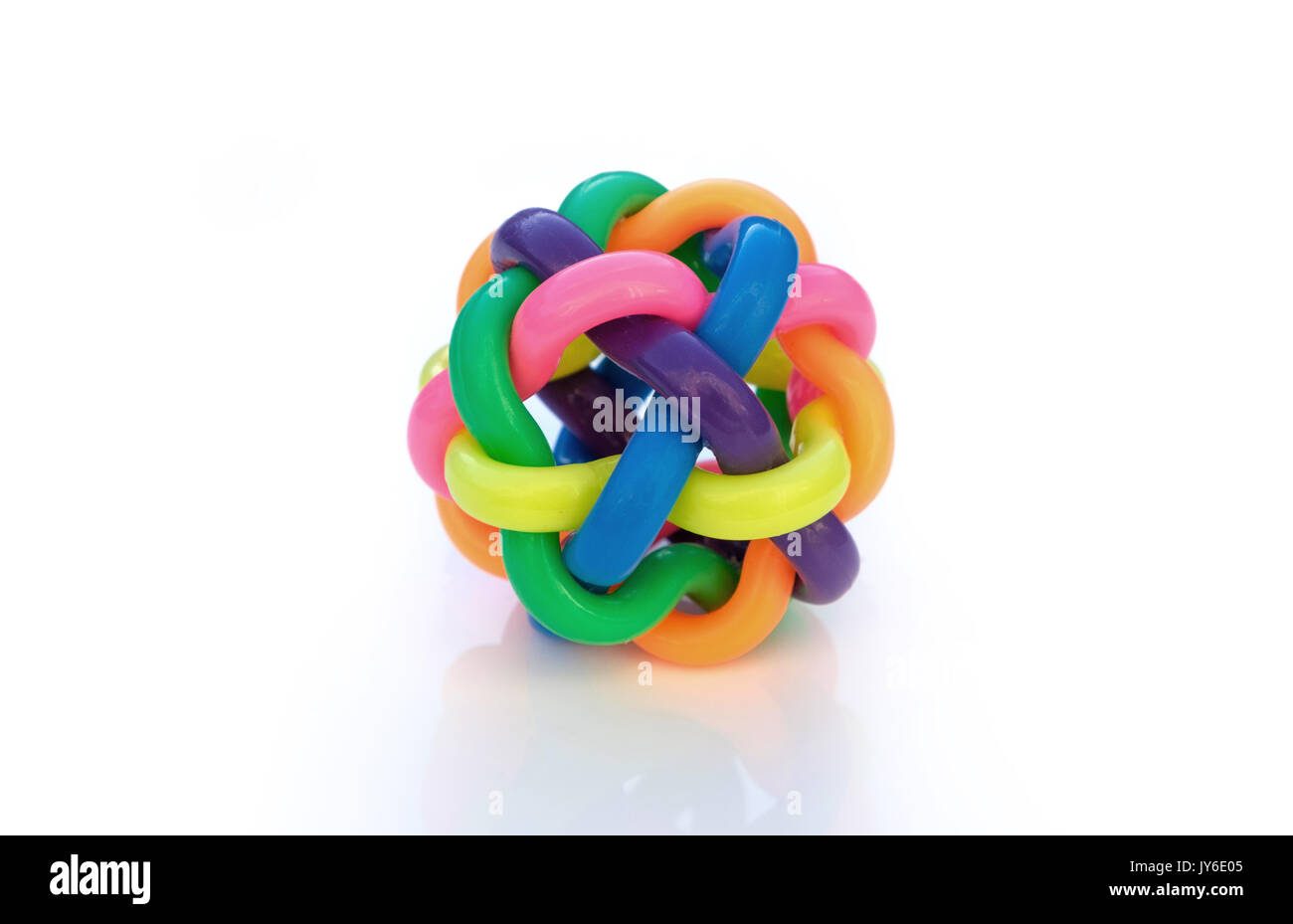 Integration concept, ball made of interwoven strands of different color plastic - Stock Image