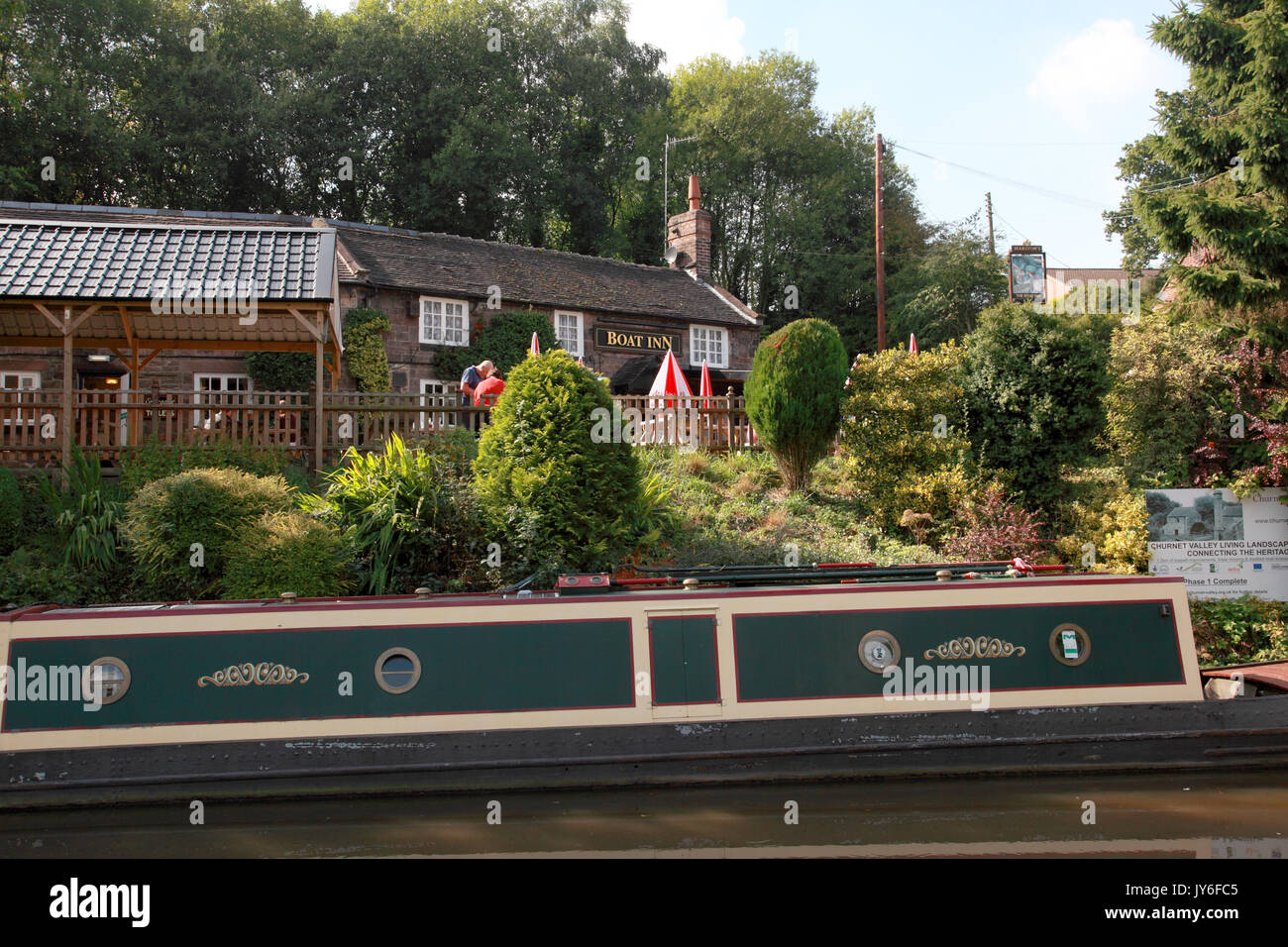 A narrowboat moored outside the Boat Inn by the Caldon Canal, Cheddleton, Staffordshire - Stock Image