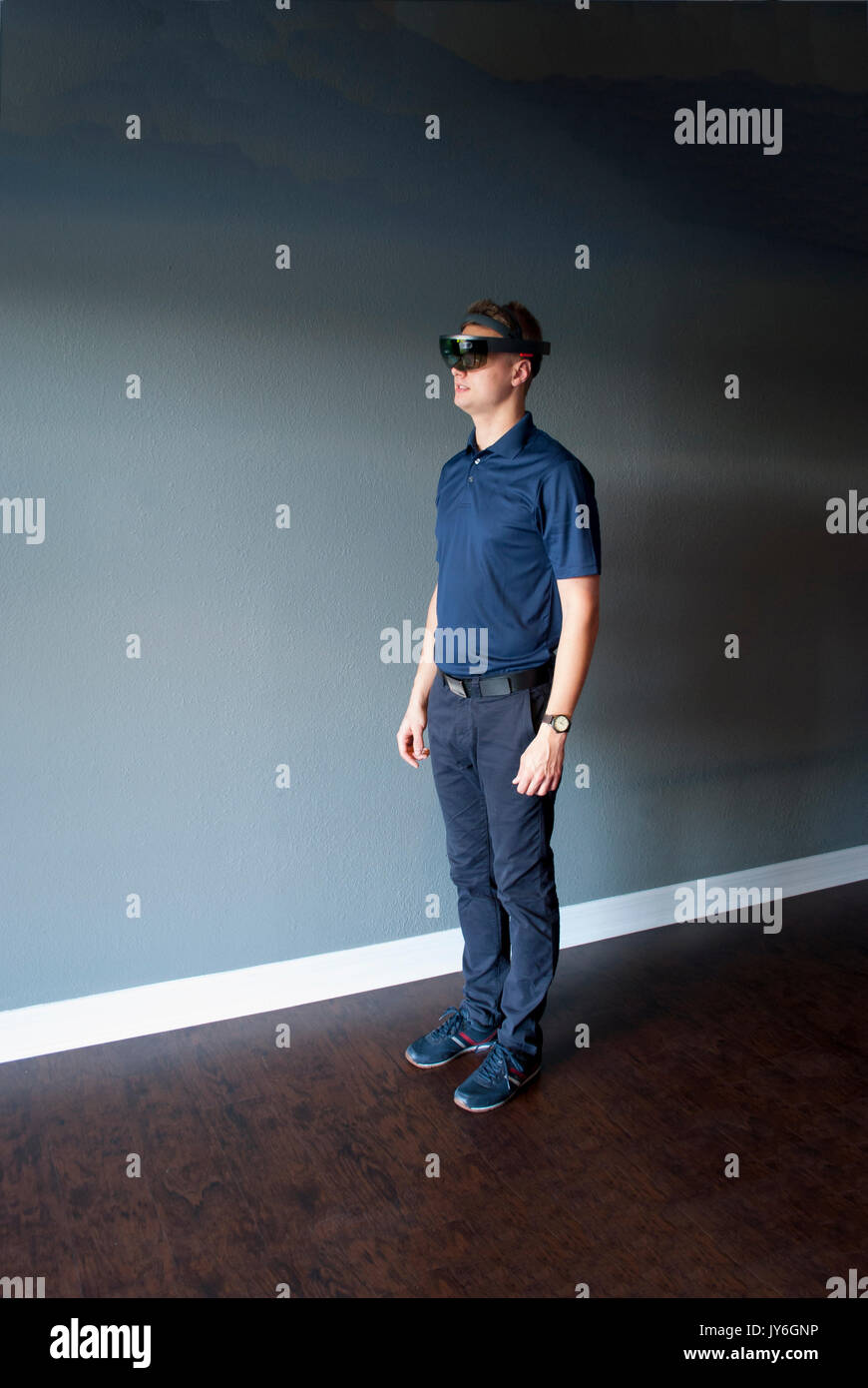 Young engineer in holographic headset creating a virtual surrounding using special gestures - gaze - Stock Image