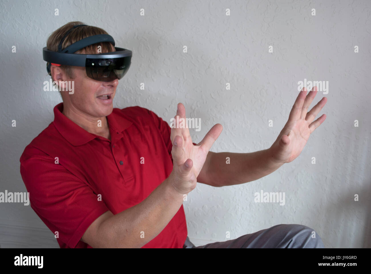 engineer working with smart glasses creating virtual reality - Stock Image