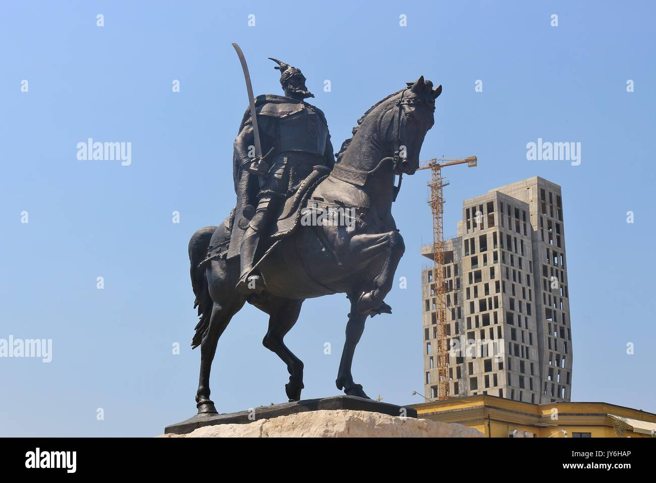 Tirana, Albania: Statue of Skanderbeg or Gjergj Kastrioti and the unfinished 4 evergreem building. On the Skanderbeg square. South-east Europe. - Stock Image