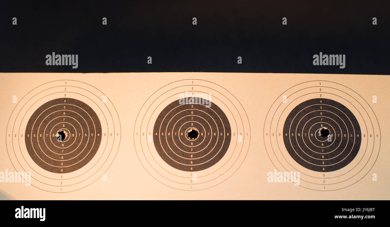 Shooting in the centre of the target - Stock Image
