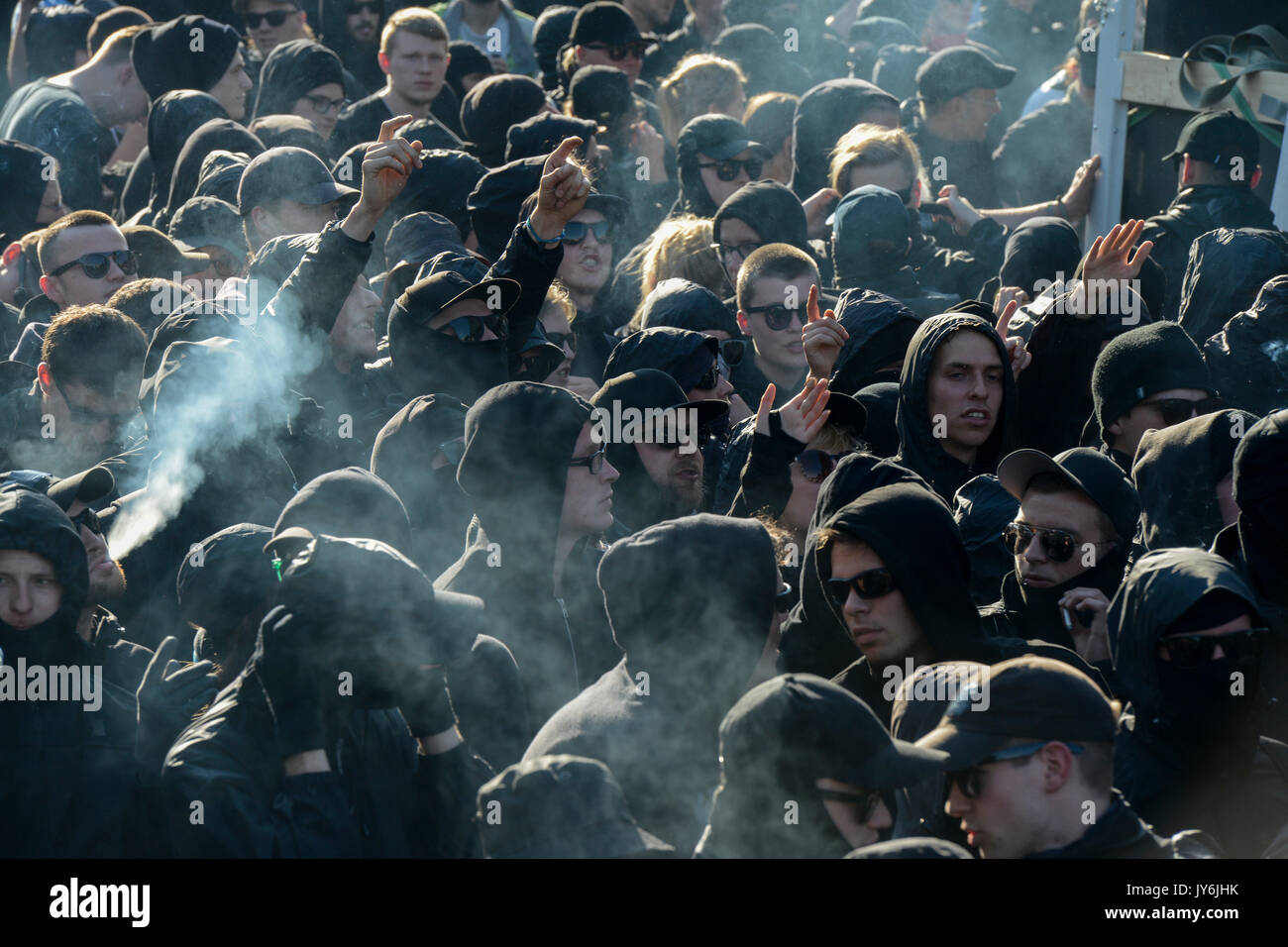 GERMANY, Hamburg, protest rally 'G-20 WELCOME TO HELL' against G-20 summit in july 2017, black mummed protester smoking Marihuana - Stock Image