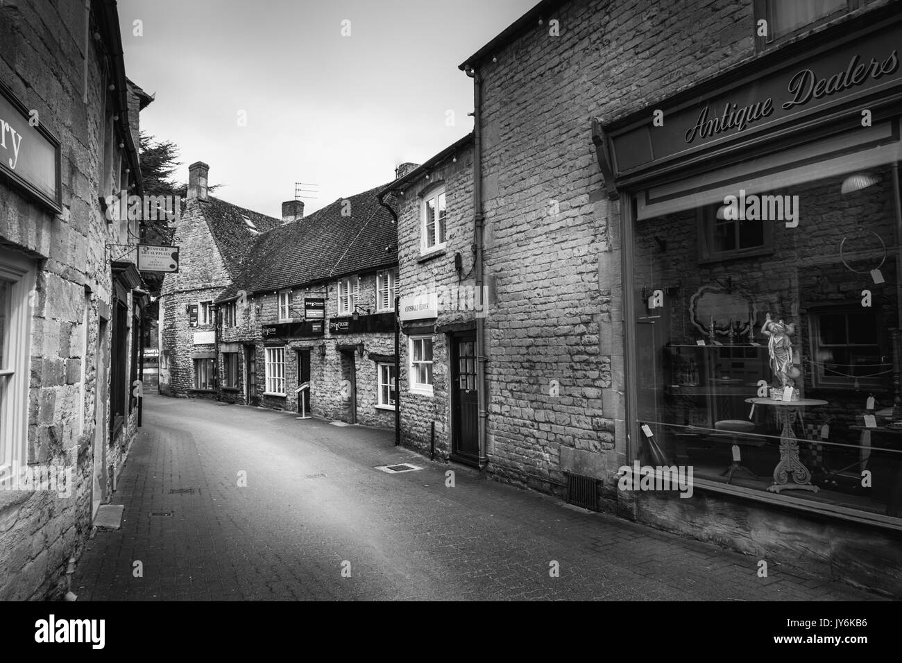 A black and white view of an old antique shop in the Cotswolds, England - Stock Image
