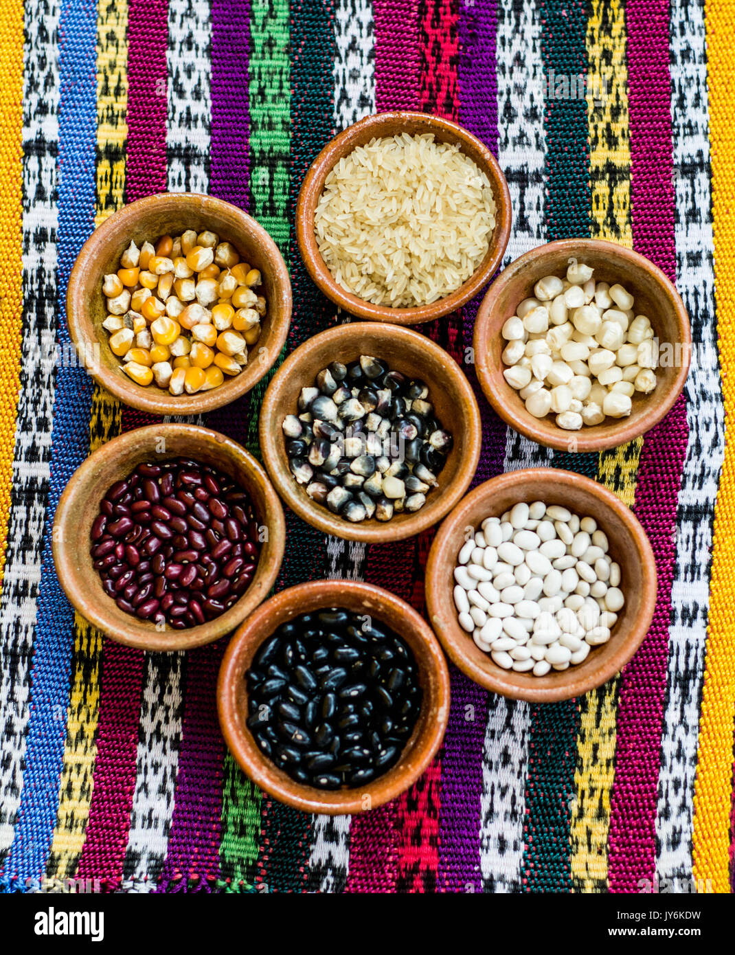 typical diferents types of corn in guatemalan food, ingedients of typical food Pepian with rice, corn and beans. - Stock Image