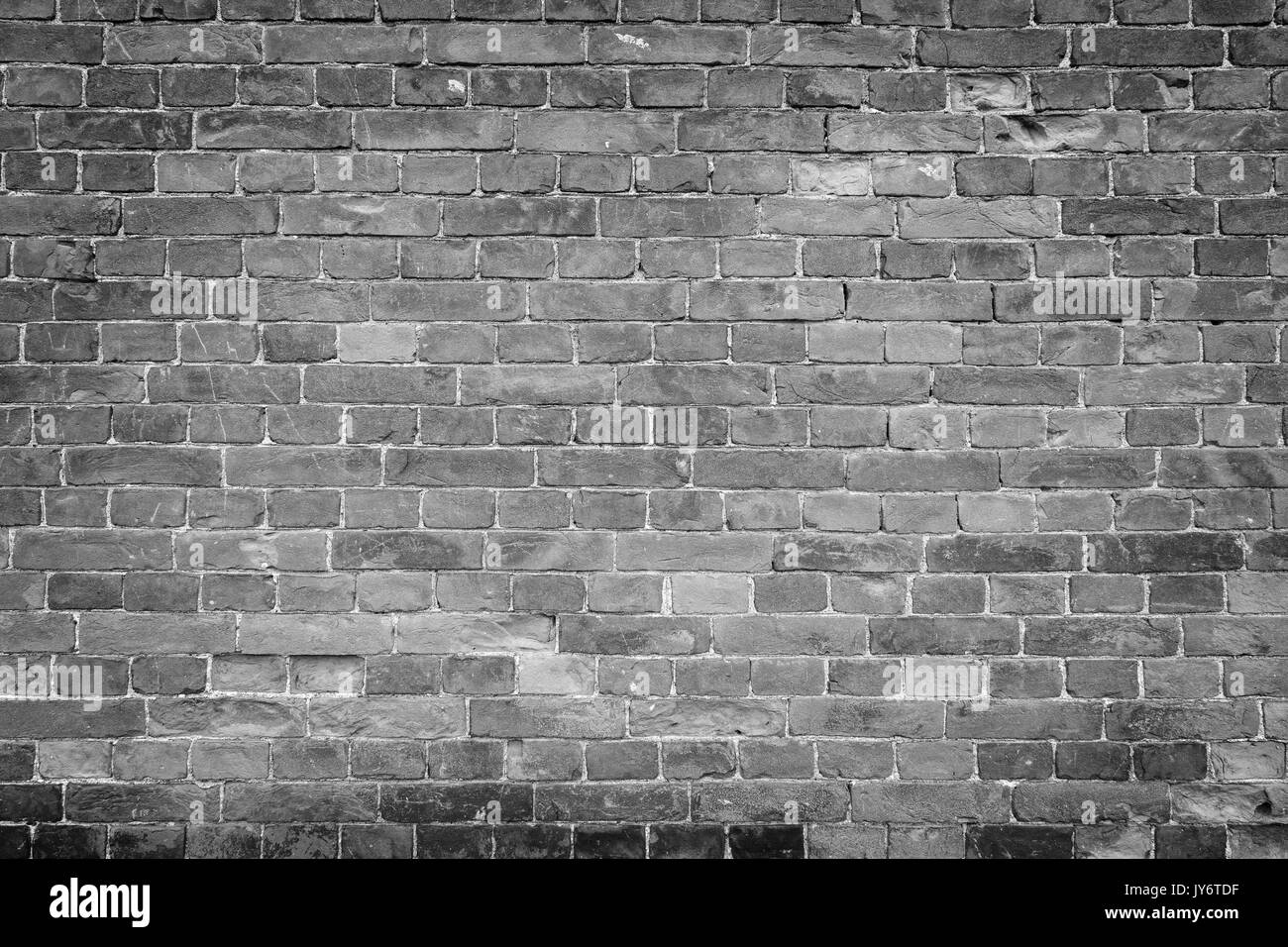 black stone wall texture gray wall old and aged brick wall texture background with vignetting in black white stock brick wall background black white photos images alamy