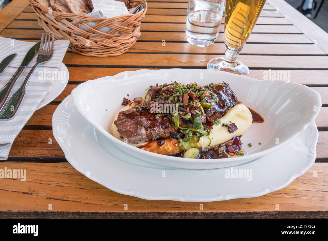 Shoemaker's box is a traditional Swedish dish consisting of beef served on mashed potatoes with gravy and garnished with diced bacon and chopped piece - Stock Image