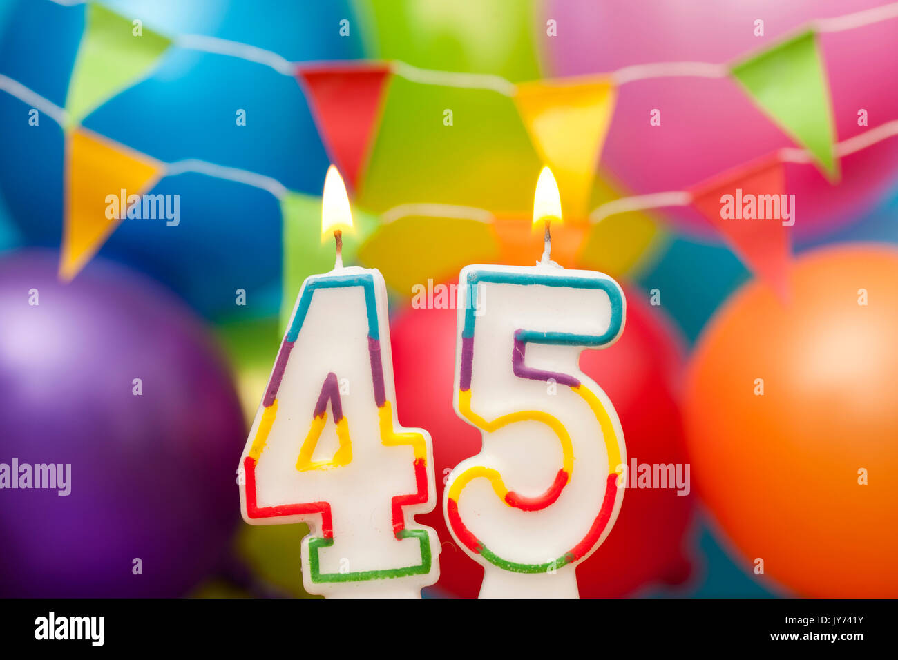 Happy Birthday Number 45 Celebration Candle With Colorful Balloons And Bunting