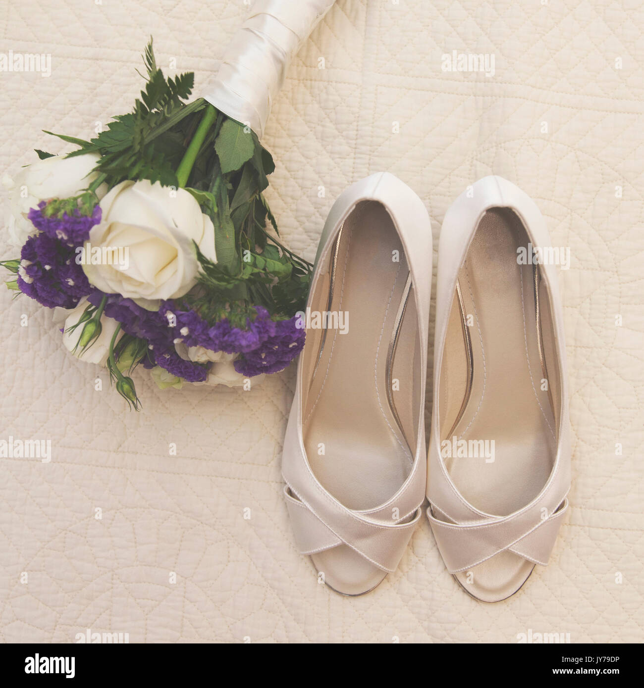 2c6f9e2a410 Wedding day detail. Bridal shoes and bouquet Stock Photo  154439762 ...