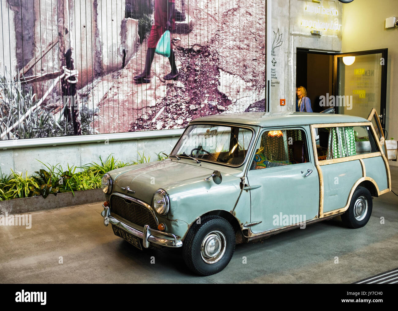 Berlin Charlottenburg.Classic Morris Mini Traveller, Austin Mini Countryman two-door estate car. Rusty automobile with curtains and lampshade - Stock Image