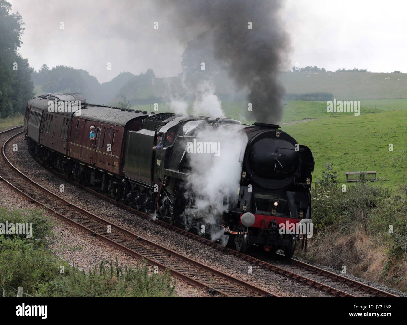 Merchant Navy class preserved steam locomotive British India Line, number 35018, on a loaded test run from Carnforth in the countryside near Borwick. - Stock Image