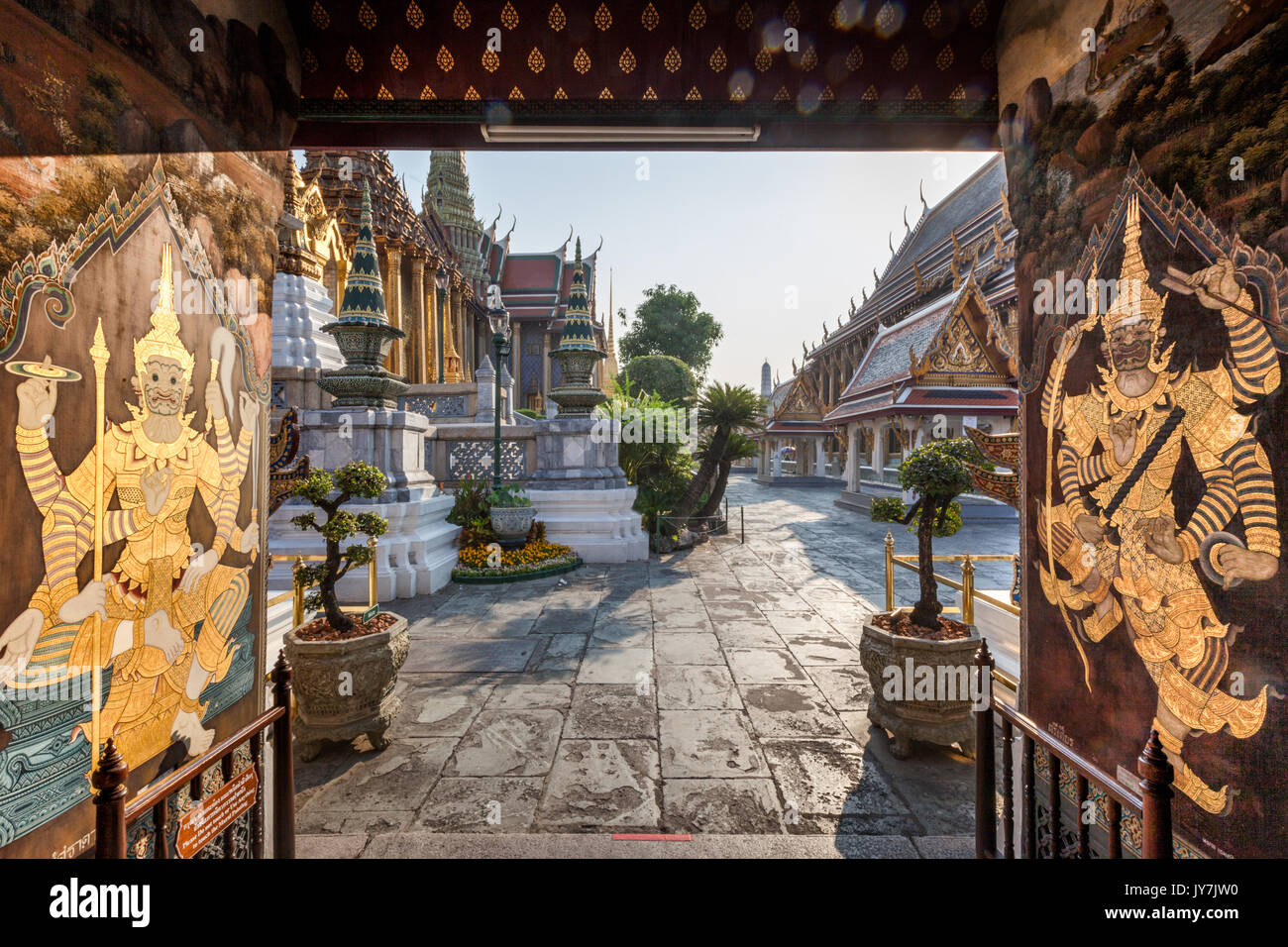 Ornate entrance door with gold decoration at Wat Phra Kaew Temple of the Emerald Buddha inside the Grand Palace, Bangkok, Thailand - Stock Image