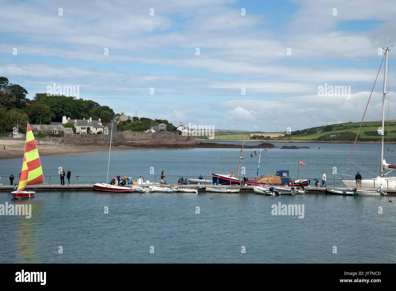 Dale, West Wales. Small boats in the harbour by the pontoon about to set sail. - Stock Image