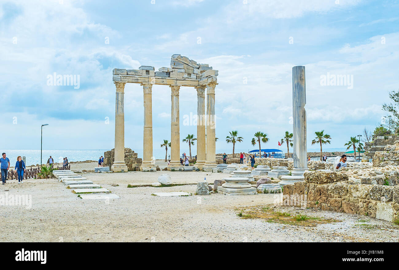 SIDE, TURKEY - MAY 8, 2017: The most beautiful and famous archaeological site of resort with ancient ruins of Apollo Temple, located on the seashore,  - Stock Image