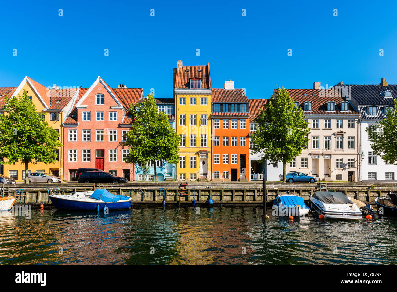 Colourful houses along canal in Copenhagen Denmark - Stock Image