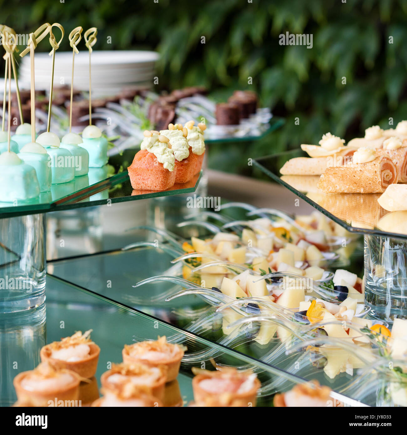 Appetizers, Finger Food, Party Food, Sliders. Canape, Tapas. Served Table  At Summer Terrace Cafe. Catering Service. Outdoor Restaurant Table With  Food.