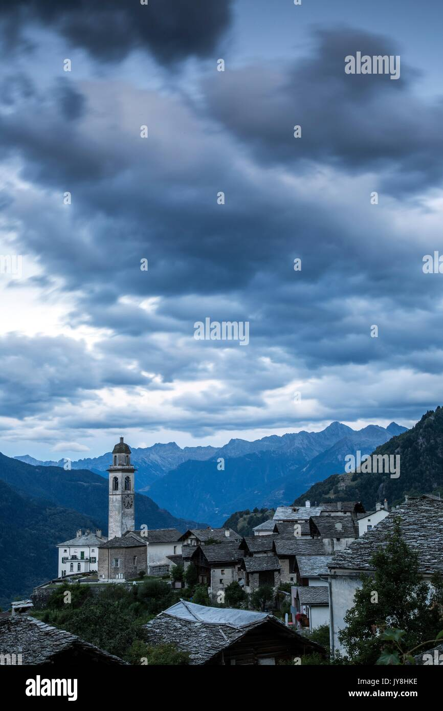 Threatening clouds in the sky at Soglio during the blue hour. Val Bregaglia Canton of Graubunden Switzerland Europe - Stock Image