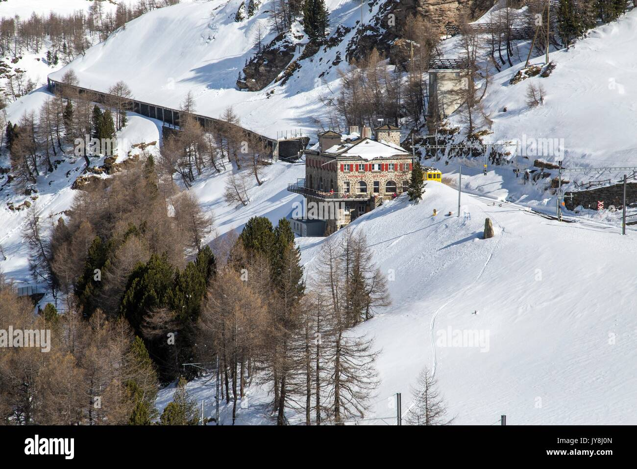 Aerial view of the Raethian Railway of Alp Grum. Bernina Pass, Poschiavo Valley, Canton of Grisons Switzerland Europe - Stock Image