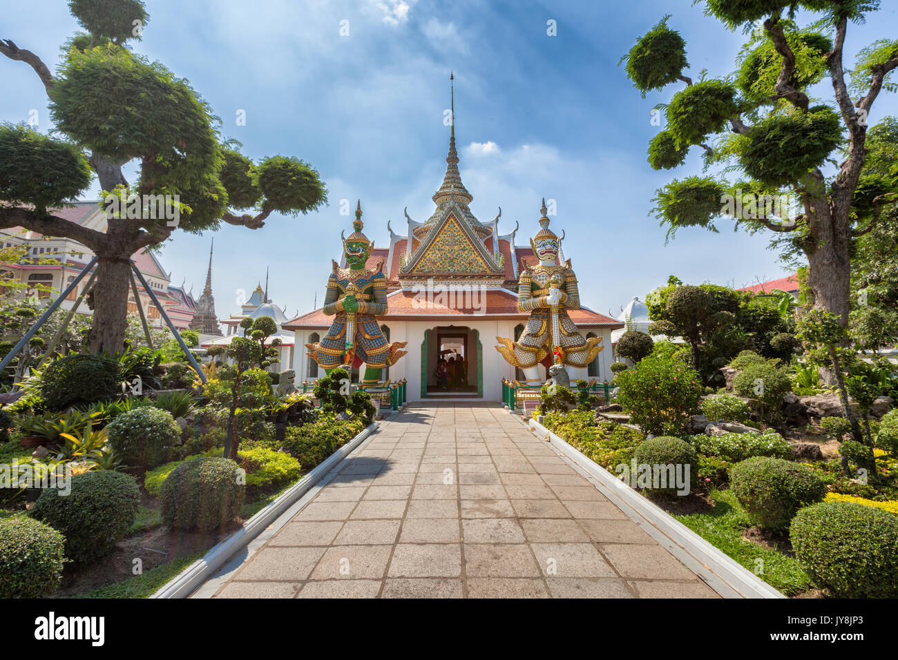 Giant demon guardian statues at the entrance of Wat Arun, Bangkok, Thailand - Stock Image