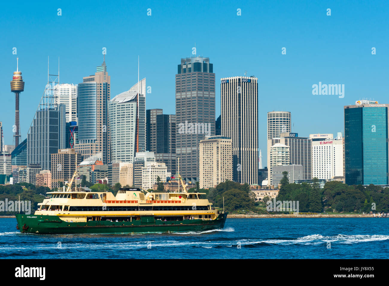 Sydney ferry in front of the city skyline. Sydney, New South Wales, Australia. Stock Photo