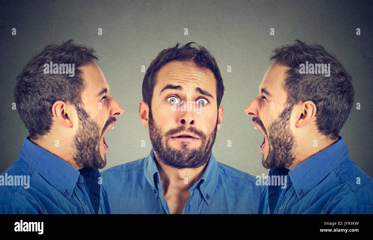Split personality concept. Two angry men screaming at scared himself - Stock Image