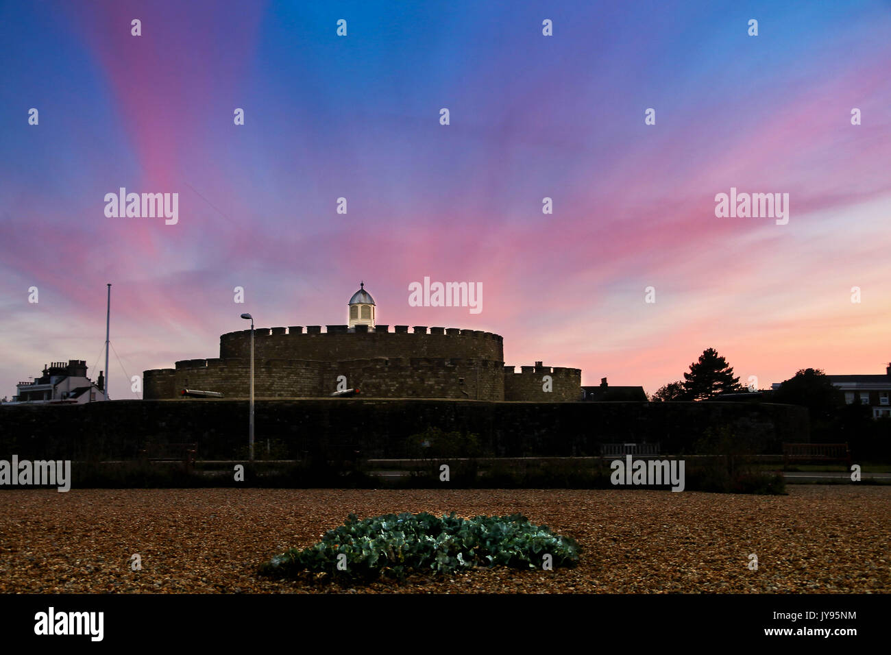 Pink, Purple, Orange and Blue skies over Deal Castle - Stock Image