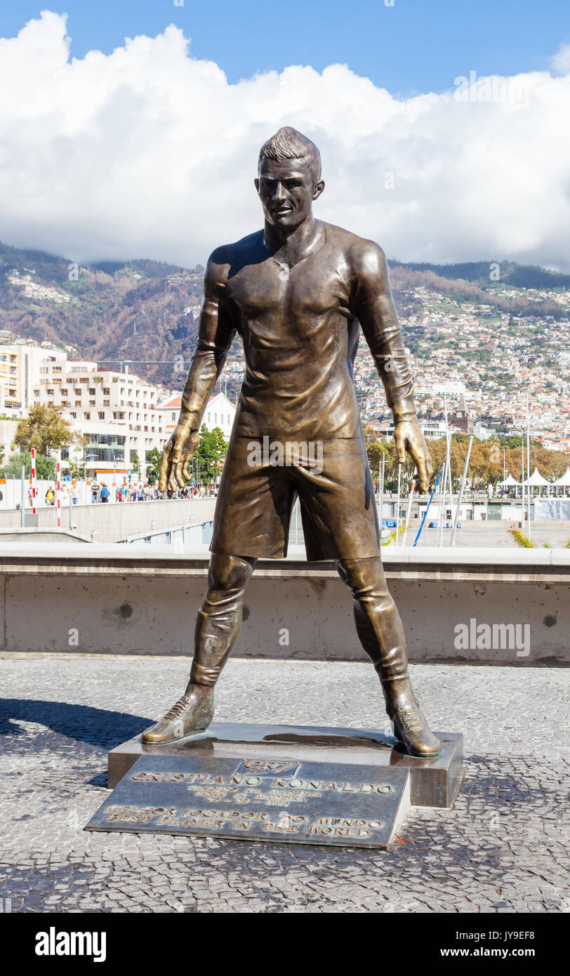 A statue of footballer Christiano Ronaldo is pictured on the Funchal waterfront on the Portuguese island of Madeira. - Stock Image