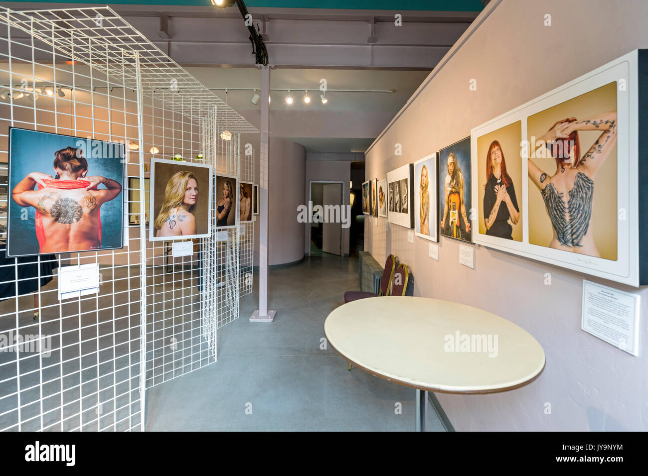 Photographic Gicleé prints of tattooed people; Paquette Gallery; SteamPlant Event Center; Salida; Colorado; USA - Stock Image