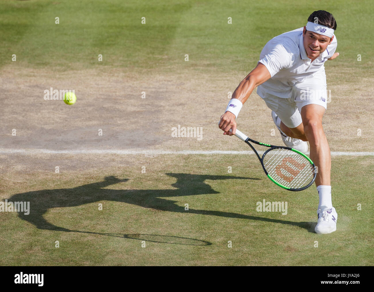MILOS RAONIC in action at Wimbledon . - Stock Image