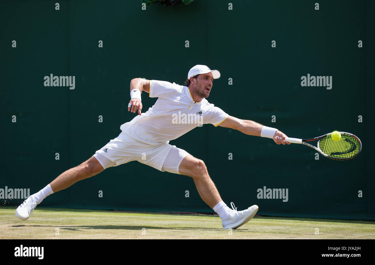 Mischa Zverev in action at  Wimbledon, London, Great Britain, United Kingdom. - Stock Image