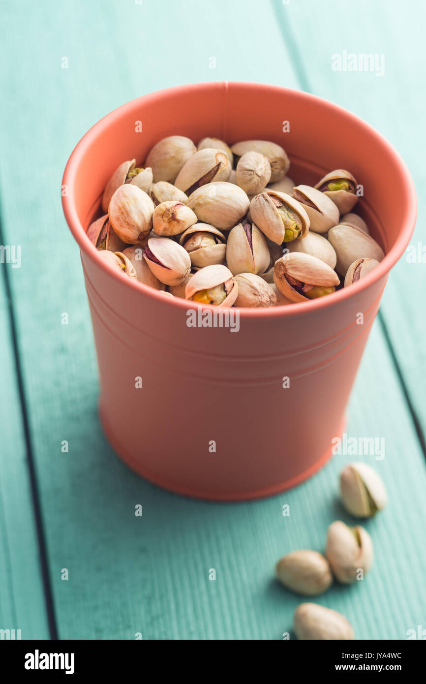 Dried pistachio nuts in cup.  Pistachio kernel. - Stock Image