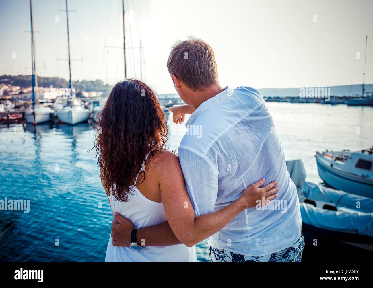 Back view, couple hug on boat marine background - Stock Image