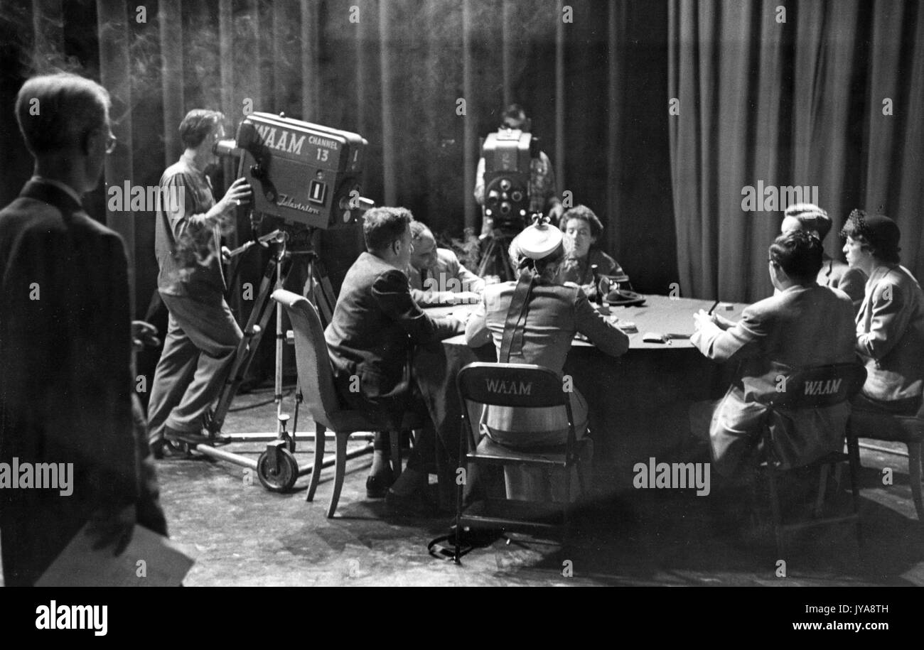 Dr Jerome Frank, influential American psychiatrist and Professor of Psychiatry at the Johns Hopkins University Medical School, and staff on set for 'Troubled People Meet' segment of the Johns Hopkins Review television program, 1951. - Stock Image
