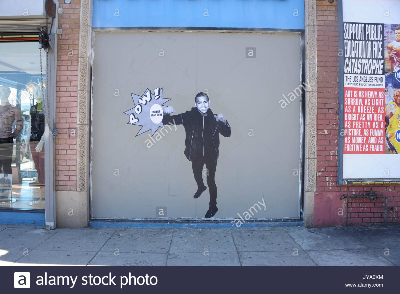 Chris Brown Graffiti A Los Angeles Graffiti Artist Portrays A Chris Brown Figure With A Pow Caption On The Side Of A Clothing Store On Melrose Ave In
