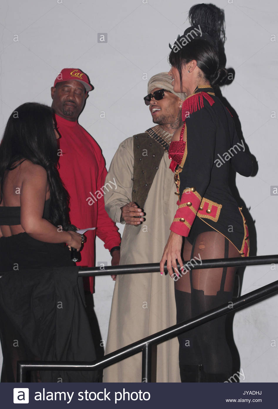 christian audigier kevin hart chris brown and paris hilton in costumes at a halloween party at the graystone club in hollywood ca