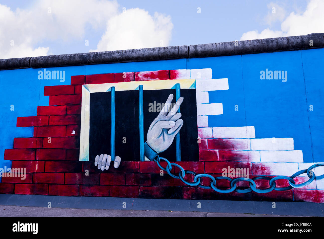 The Berlin Wall that divided East from West Berlin in Germany.This is        the Eastside Gallery of the Berlin Wall in Berlin Germany - Stock Image