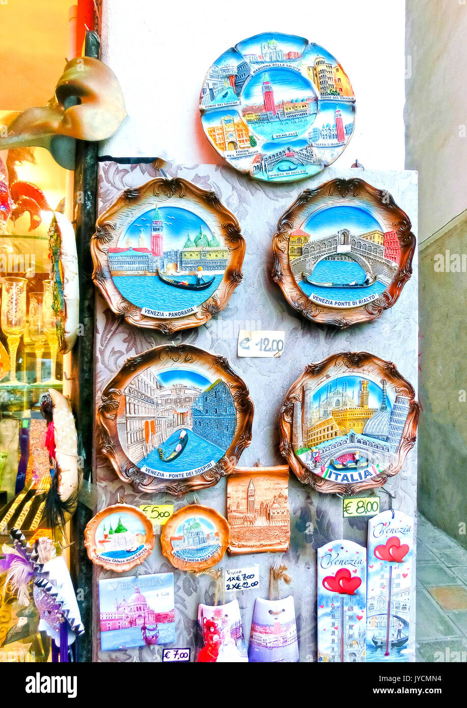 Venice, Italy - May 04, 2017: Vendors stands - profitable and popular form of sales traditional souvenirs and gifts like masks, magnets, clothes and travel guides to tourists visiting Venice. - Stock Image