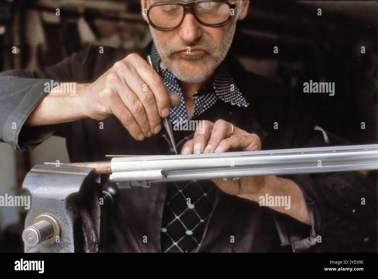 Craftsman artistic engraver of shotguns in Gardone Valtrompia Stock