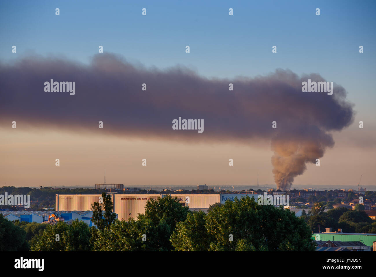 Smoke from the Grenfell Tower fire fills the skyline, Crystal Palace and Croydon Transmitters visible in the background. Photograph taken from Wembley - Stock Image
