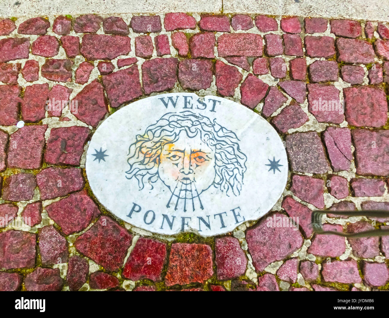 Vatican city - May 02, 2014: A stone laid in St Peter's Square at Vatican City, by Bernini points in the direction - Stock Image