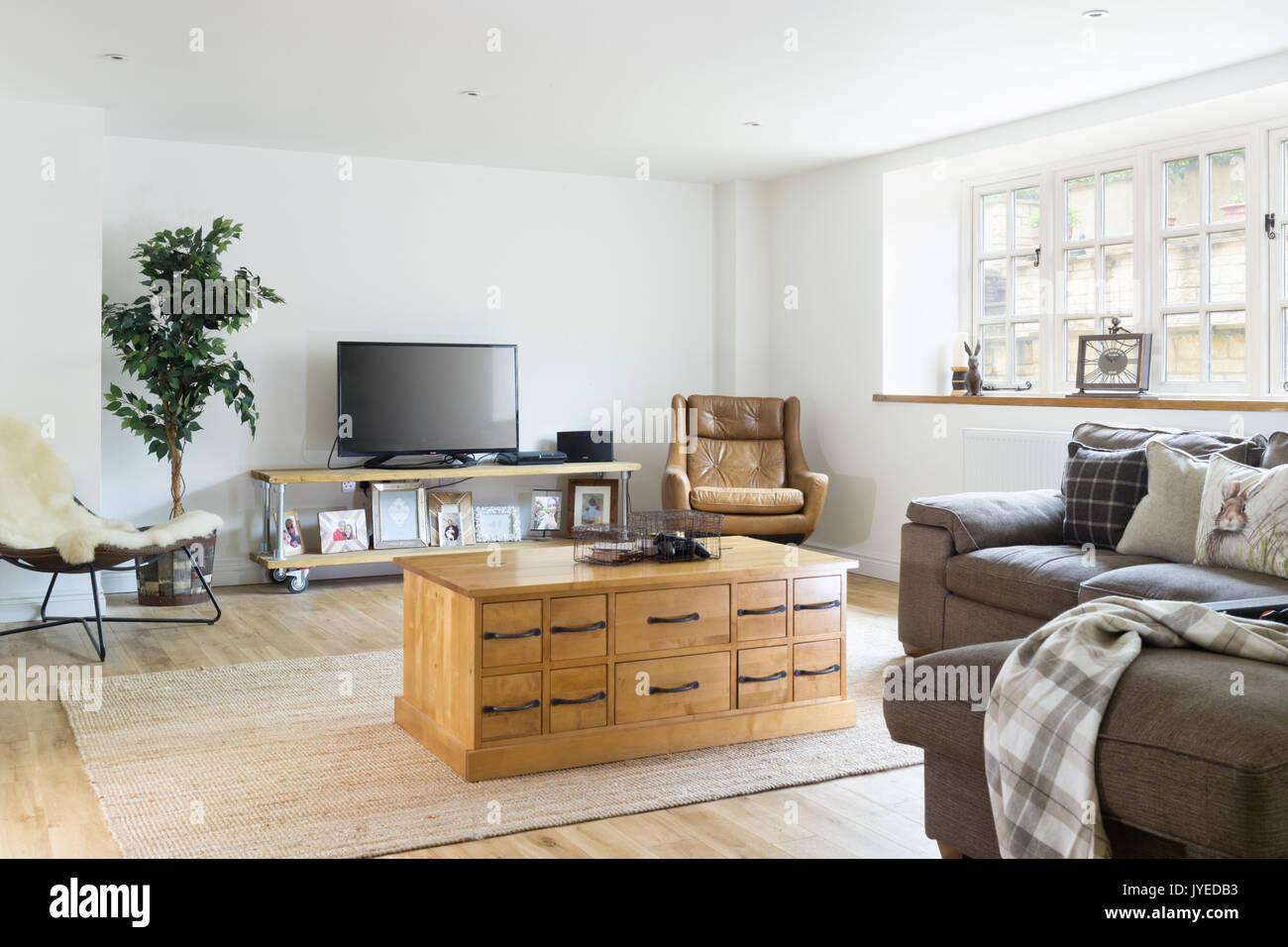 A large, open, comfortable modern  livingroom - Stock Image