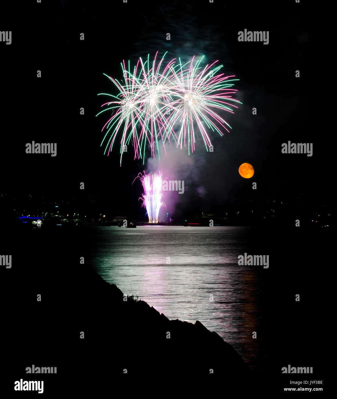PLYMOUTH, ENGLAND. 10th August 2017. The moon rises during the British Firework Championships, a huge firework competition held annually in Britain's  - Stock Image