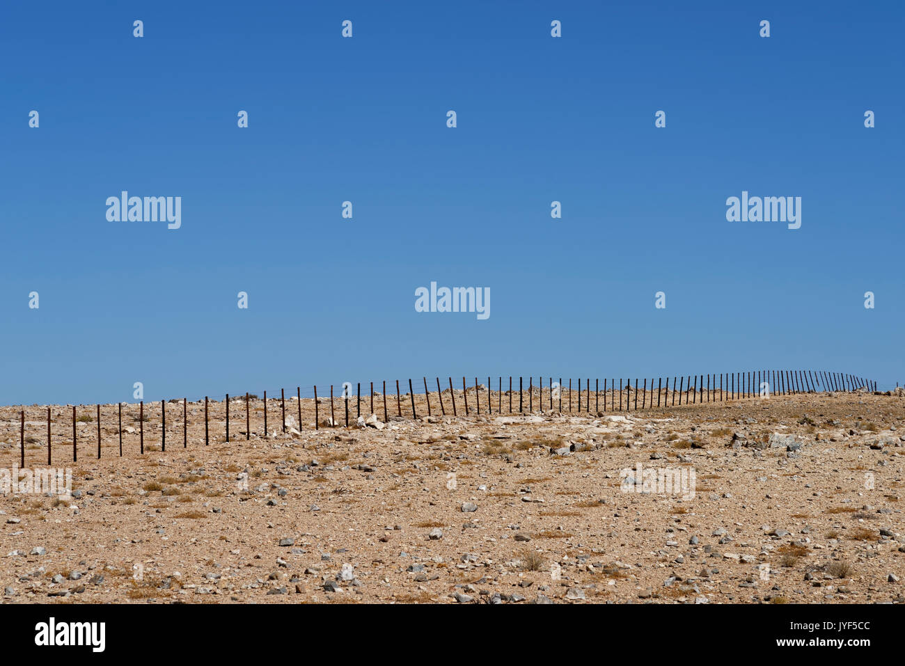 Farm Wüstenquell (Wuestenquell Guest Farm): Farm fence in Namib Desert, Distrikt Karibib, Namibia - Stock Image